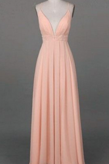 A pale pink ball gown and a sleeveless gown with a simple shoulder strap, evening dress.