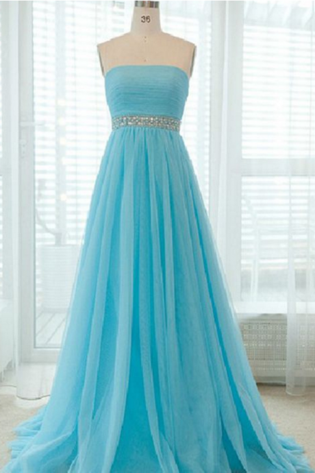 A strapless long blue dress with pleated bodice and evening dress.