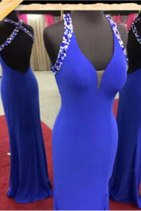 A long royal blue ball gown with strapless straps, evening dress.