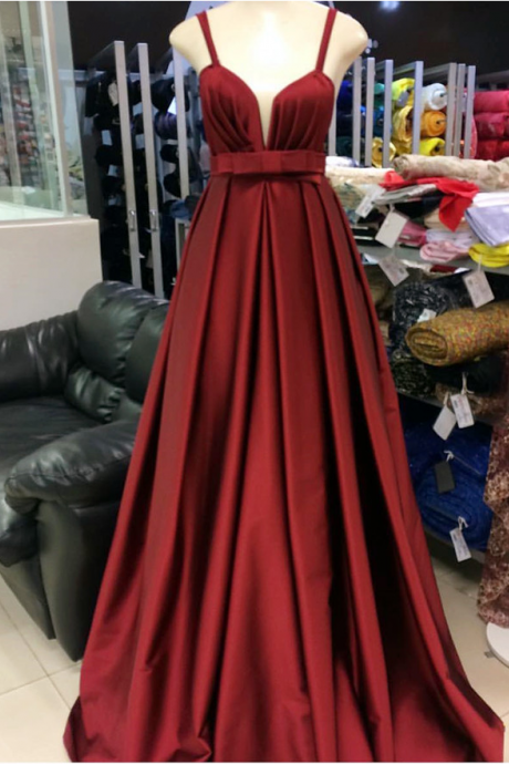 A low-necked gown with a fine shoulder and a red cocktail dress.